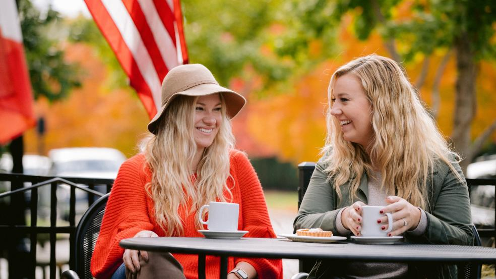 Two girls enjoying coffee on the La Chatelaine patio in Historic Dublin