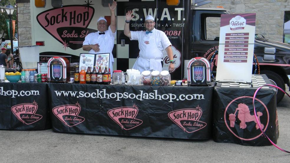 Sock Hop Sodas stand waving to the crowd at the Historic Dublin Street Bazaar