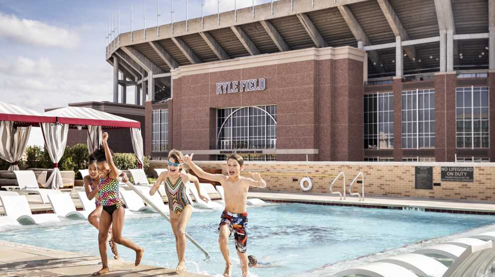 TAMU Hotel Kids at Pool