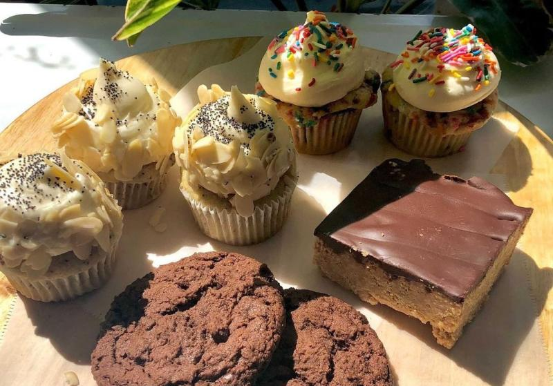 An assortment of cupcakes, cookies, and dessert bars from The Owlery