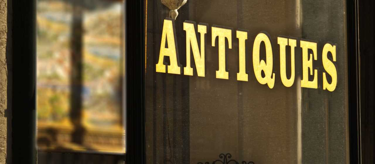 Antiques Sign on Window in Rutherford County}