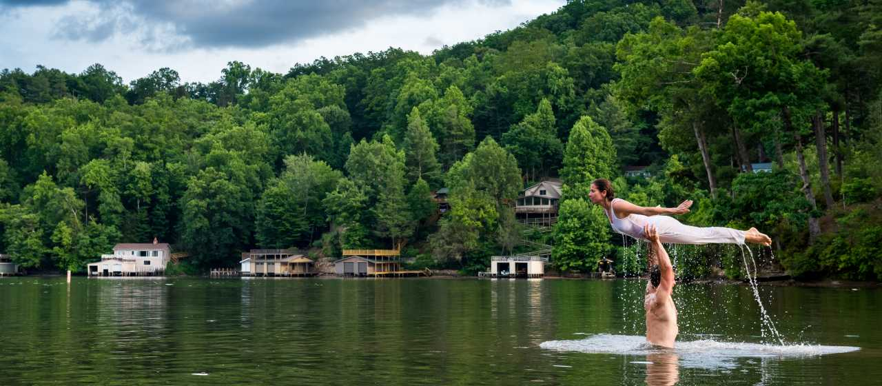Man and women recreating a Dirty Dancing scene in Lake Lure, NC}