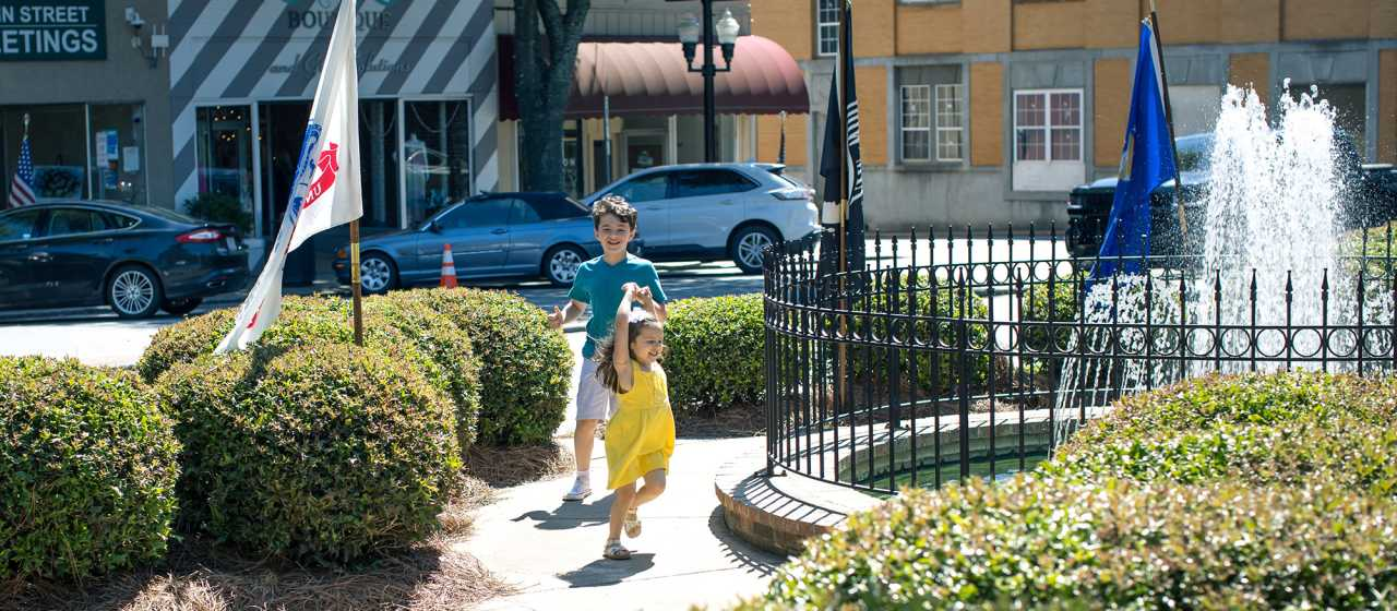 Children running in Small Carolina Town}