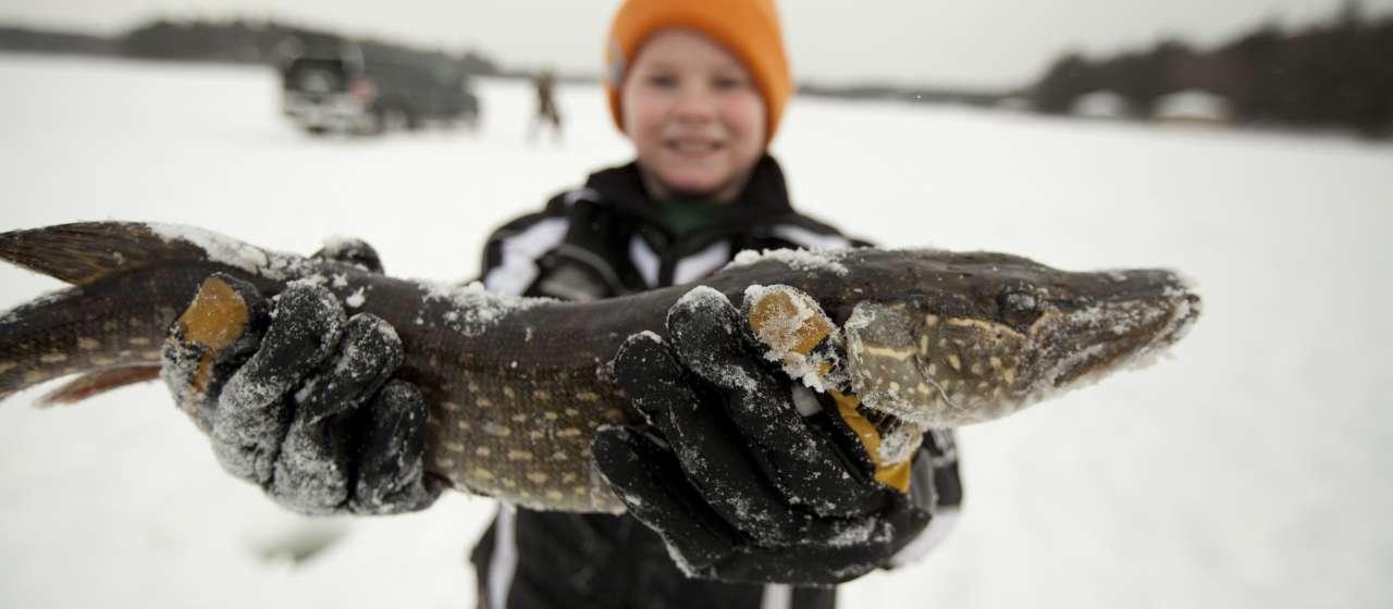 Kid ice fishing in Minocqua, WI