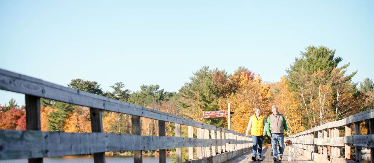 couple walking on bridge