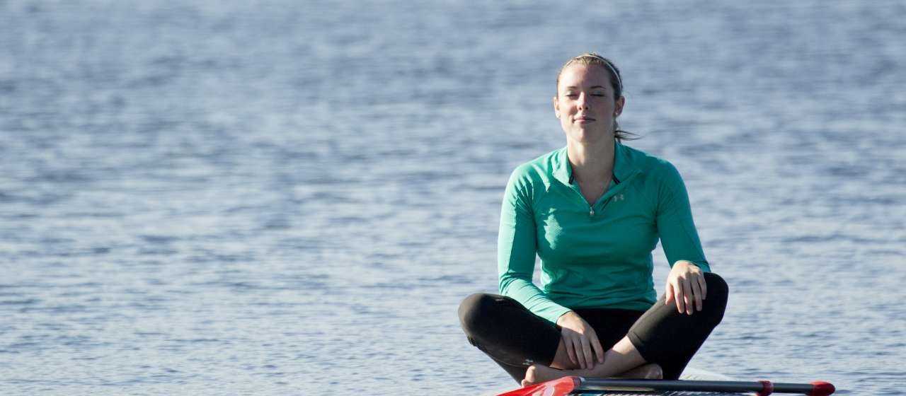 Sitting on Paddleboard