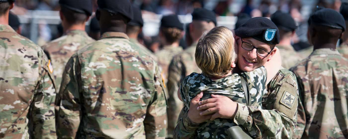 Soldier Hugging Civilian at Fort Jackson