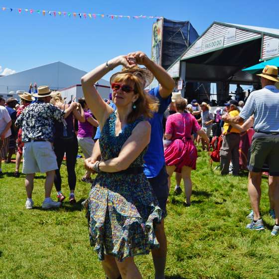 Dancing at the Fais Do Do Stage - Jazz Fest