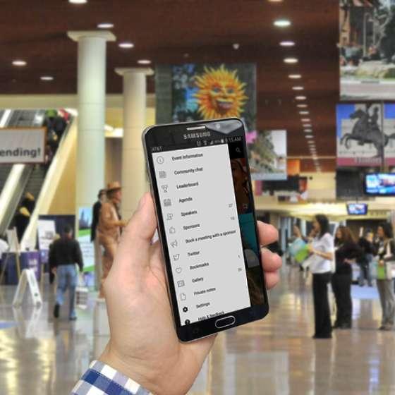 Hand holding smartphone using Topi Meeting App