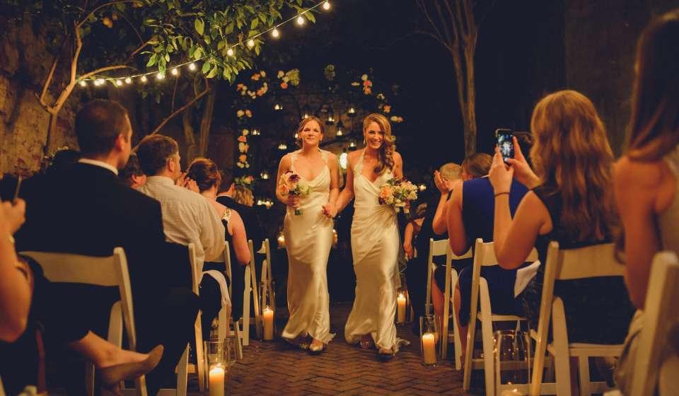 LGBT Brides at altar