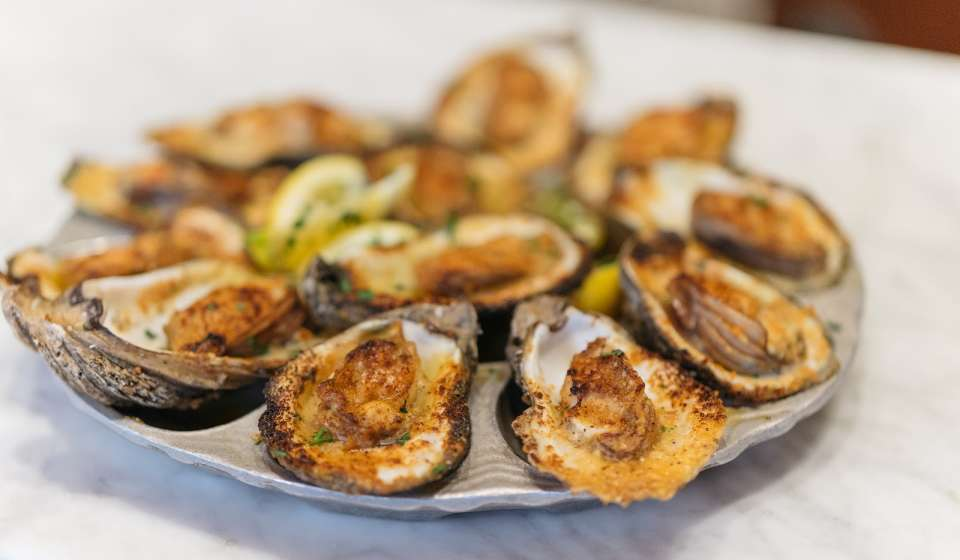 Chargrilled Oysters - Dickie Brennan's Bourbon House