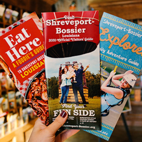 Eat Here Guide, Shreveport-Bossier Visitor Guide and Family Adventure Guide brochures