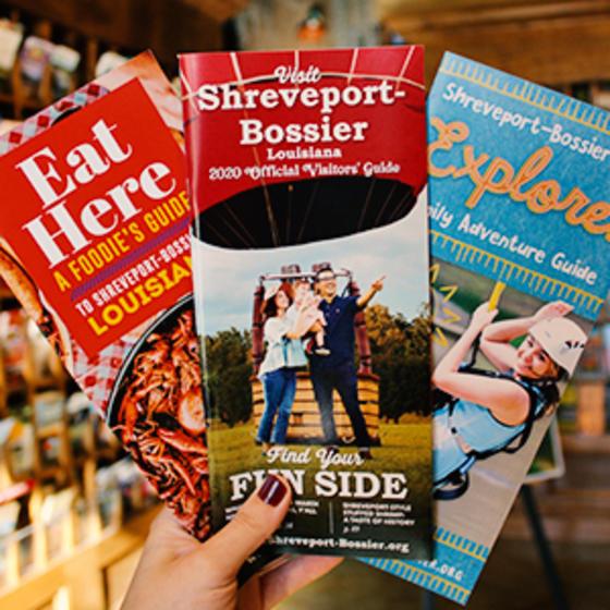 Eat Here Guide, Shreveport-Bossier Visitor Guide and Family Adventure Guide brochures