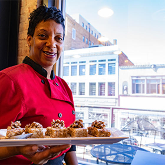 Chef Tootie Morrison of Abby Singer's Bistro in Shreveport with tray of appetizers