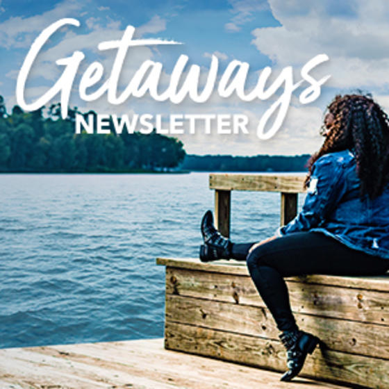 cover of Shreveport-Bossier Getaways newsletter with woman on lake shore
