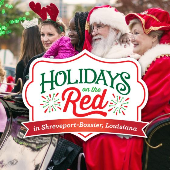 Santa and Mrs. Claus in a sleigh during Holidays on the Red in Shreveport-Bossier