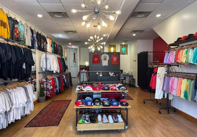 Sneakers, apparel, and accessories on display at SLCT Stock