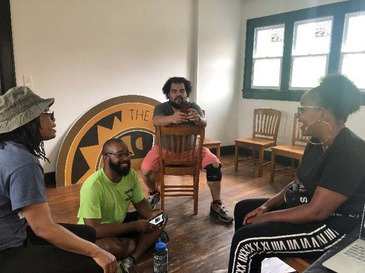 Black Owned Businesses Leaders Sitting In A Meeting