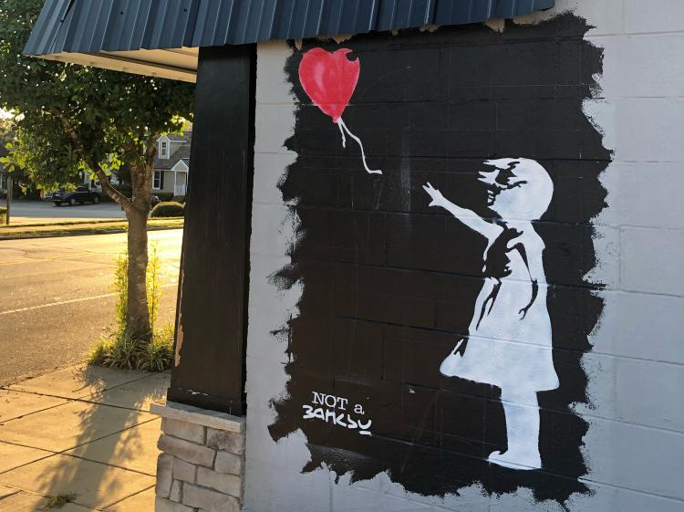Not a Banksy mural in Clayton of a child letting go of a balloon