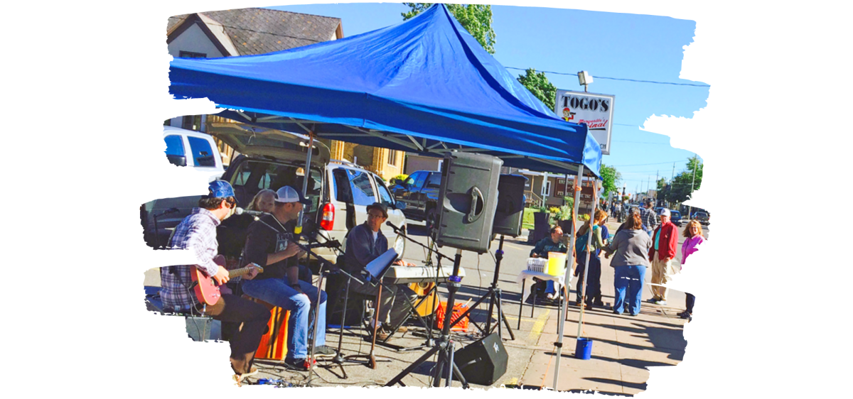 A shot of a band performing on Third St. during Marquette's Music on Third summer series