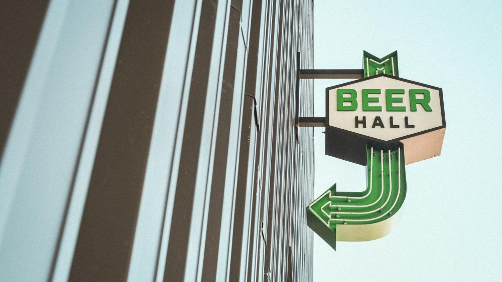 Austin FCs Q2 Stadium Beer Hall neon sign with green arrow