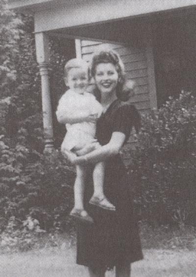 Ava Gardner holding a young Dewey Sheffield