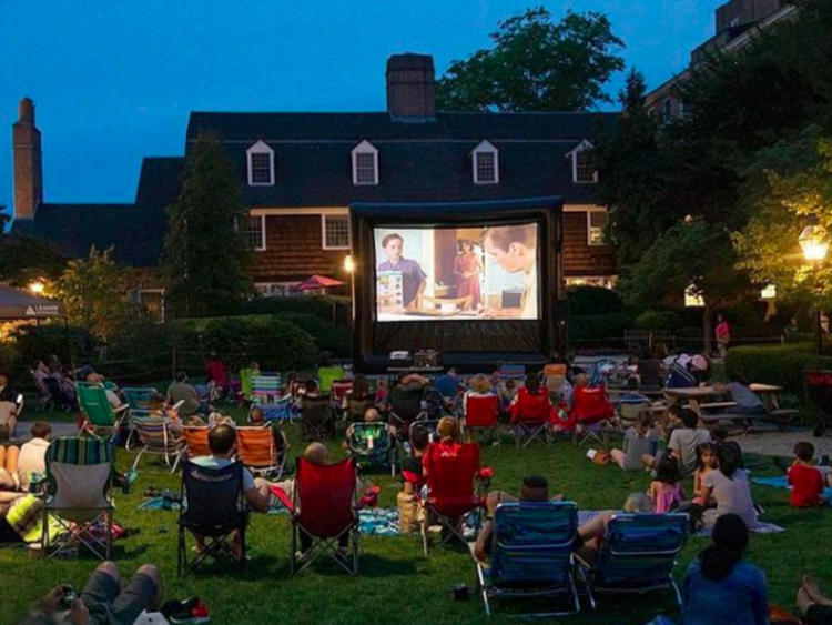 Movie night in a park with lawn chairs