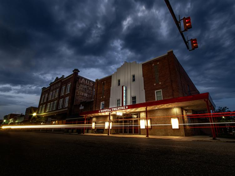 Historic Howell Theatre Exterior at Night time lapse with headlights