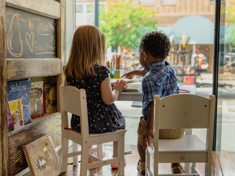 Kids playing together in window of Gilded Pear Coffee Shop