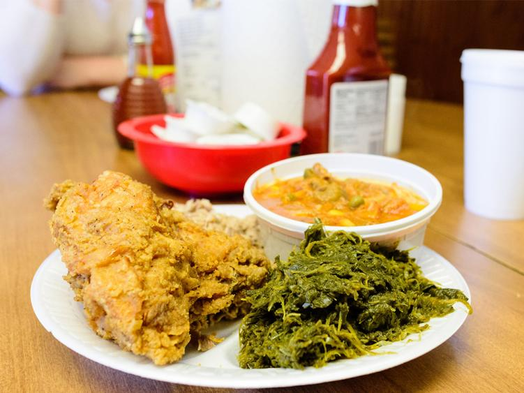 Plate of fried chicken and collards from White Swan BBQ in Smithfield, NC.