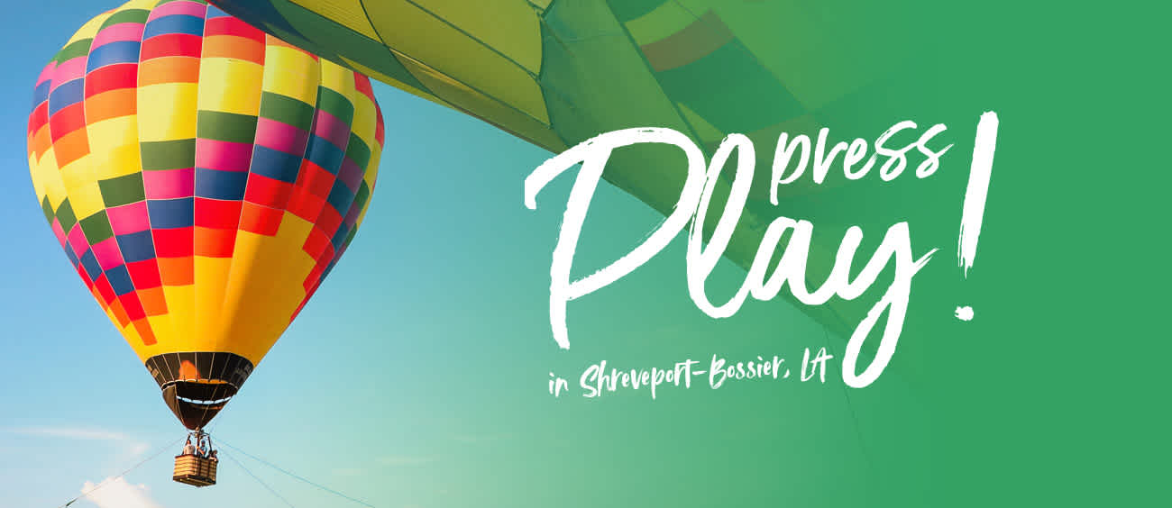 "Shreveport-Bossier ""Press Play"" promotional banner with hot air balloon"