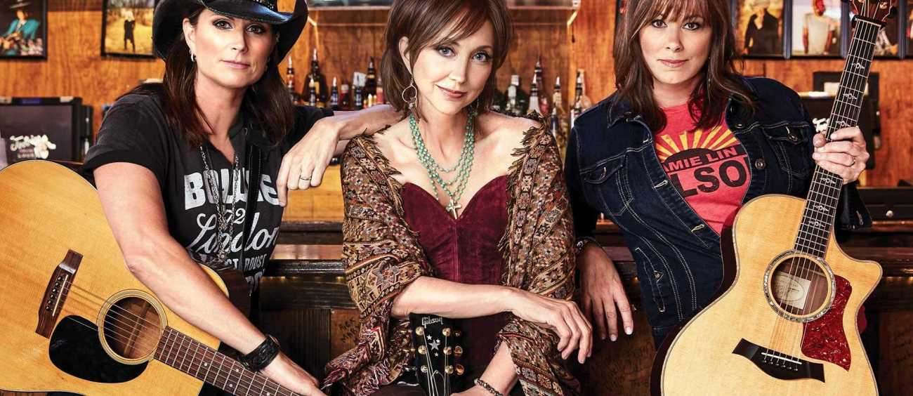 Country music female artists with instruments.