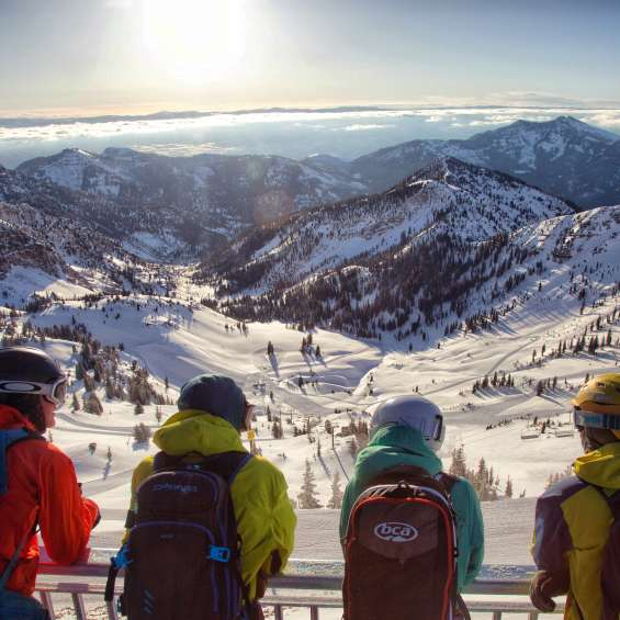 Skiers overlooking the snow-covered mountains at Snowbird