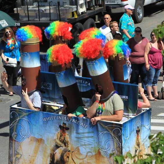 People Dressed as Rainbow Six Pack of Beer in Pride Parade
