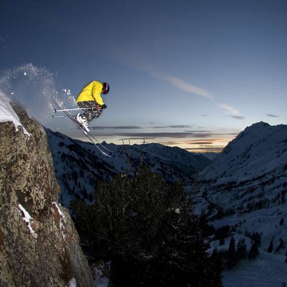 Skier Hucking Cliff at Alta Ski Area