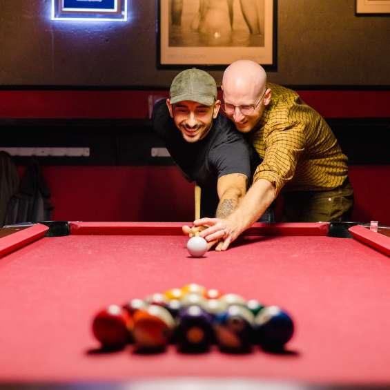 Couple Playing Pool at Bar