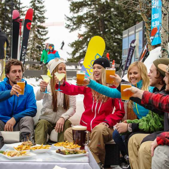 Friends Drinking at Snowbird Tram Deck after Skiing