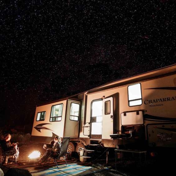 Friends enjoying starry night while RV camping