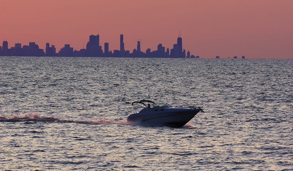 Sunset, boat and Chicago skyline