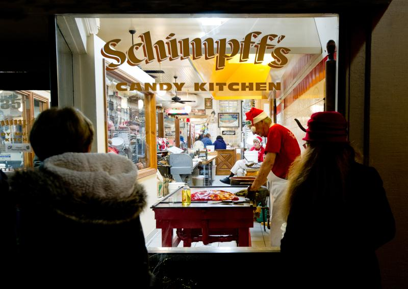 People looking in the Schimpff's candy kitchen window during the holidays