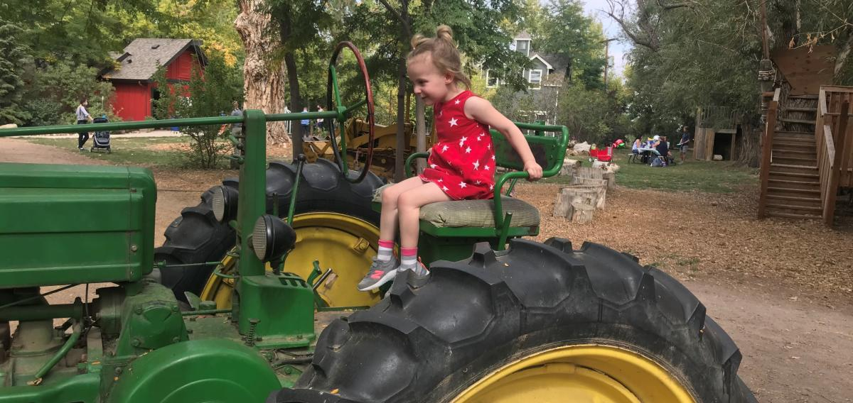 A child enjoys sitting on a tractor at Sunflower Farms outside of Boulder.