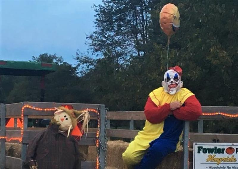 Clown sitting on a hayride at Fowler Pumpkin Patch