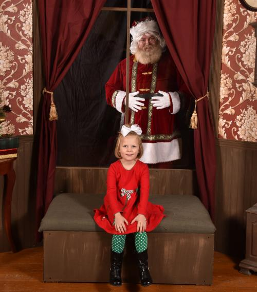 Girl poses for social distancing picture with Santa