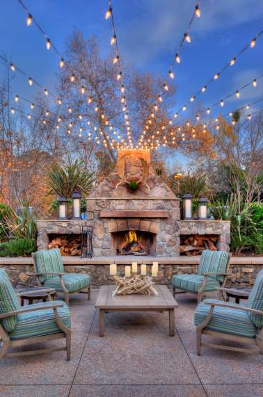 Outdoor seating area with market lights.