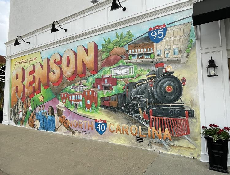 Artists working the mural; it looks like a postcard sent from Benson.