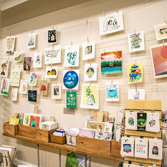 Display of wall art and prints at Gather Handmade Shoppe