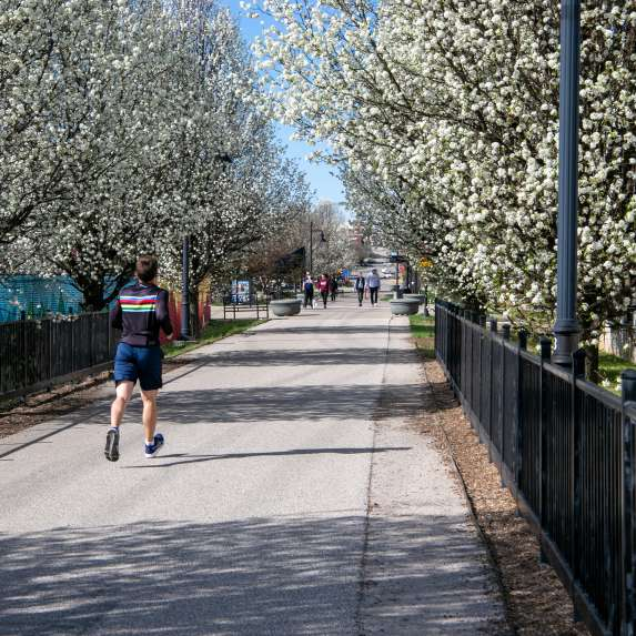 Man running on the B-Line Trail