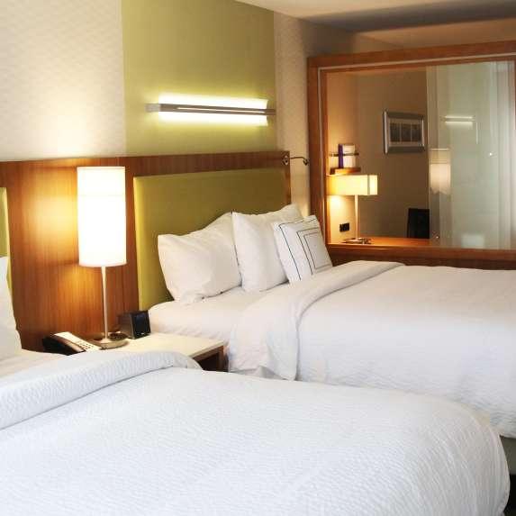 Two-queen hotel room in Bloomington