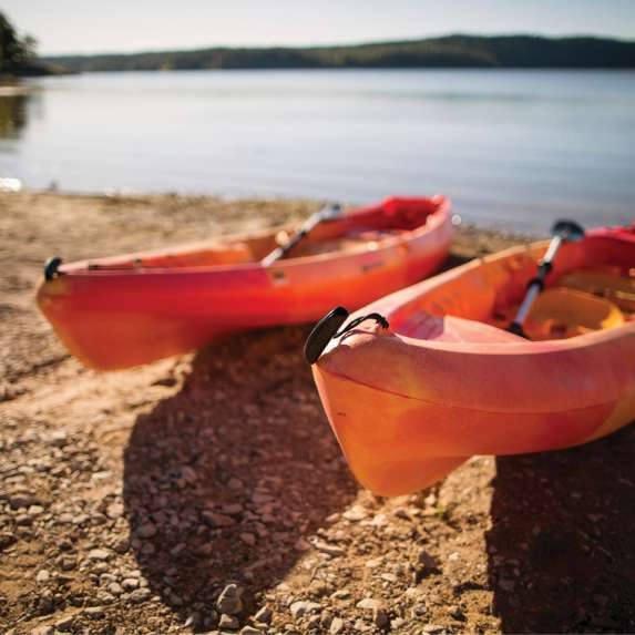 Kayaks on the shore of Monroe Lake