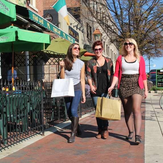 Woman walking downtown carrying shopping bags
